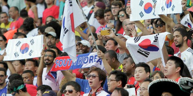 Fans of South Korea cheer before the group C match of the men's Olympic football tournament between Germany...