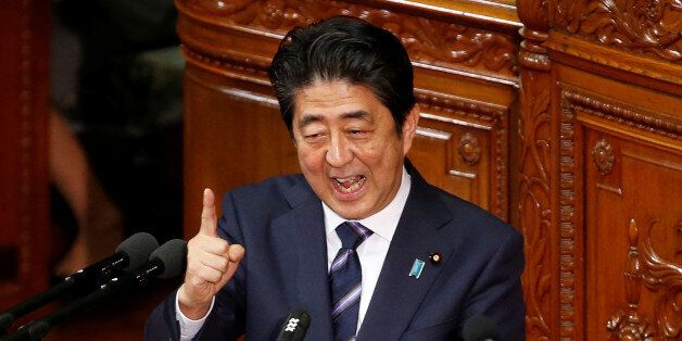 Japanese Prime minister Shinzo Abe gestures as he gives an address at the start of the new parliament...