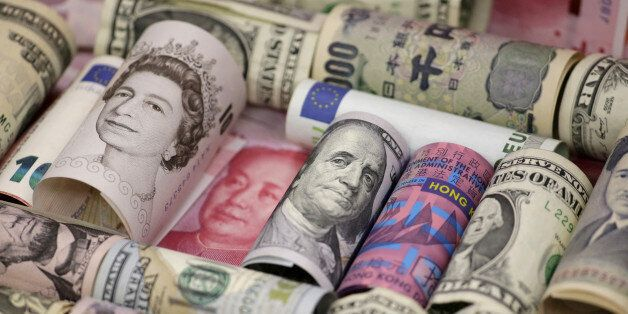 Euro, Hong Kong dollar, U.S. dollar, Japanese yen, British pound and Chinese 100-yuan banknotes are seen...
