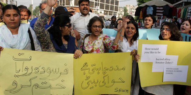 Pakistani human rights activist demonstrate against the honor killing, Monday, Sept. 1, 2008 in Lahore,...
