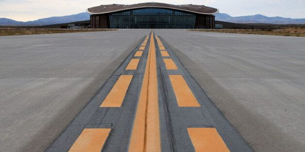 FILE - This Dec. 9, 2014, file photo shows the taxiway leading to the hangar at Spaceport America in...