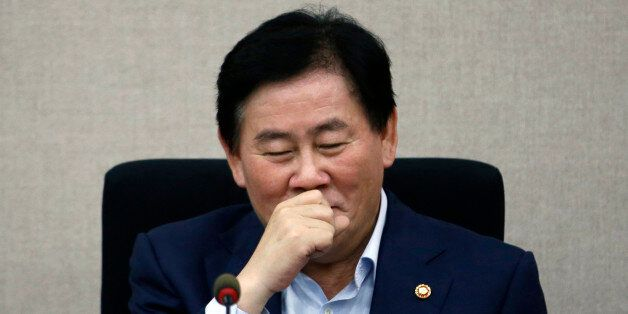 South Korea's Finance Minister Choi Kyung-hwan reacts during a meeting with the managing committee of...