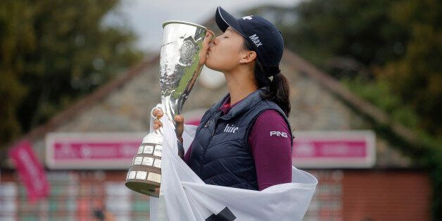 In Gee Chun of South Korea celebrates with her trophy after winning the Evian Championship women's golf...