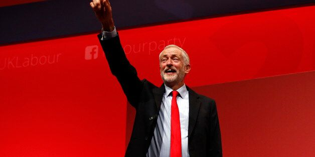 The leader of Britain's opposition Labour Party, Jeremy Corbyn, reacts after the announcement of his...