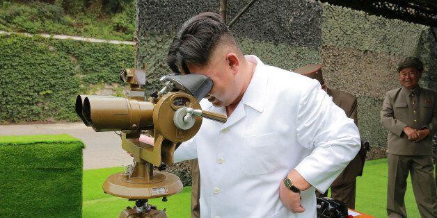 North Korean leader Kim Jong Un provides field guidance during a fire drill of ballistic rockets by Hwasong...