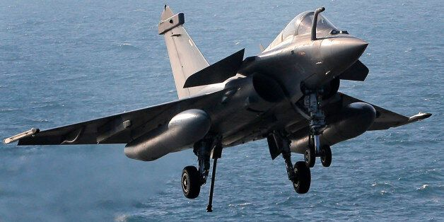 A Rafale fighter jet lands after a mission, on France's flagship Charles de Gaulle aircraft carrier in...