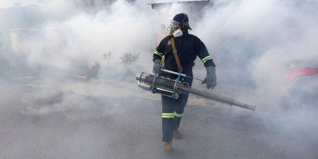 A worker from the Ministry of Health Malaysia carries out mosquito fogging at Kuala Lumpur, Malaysia,...