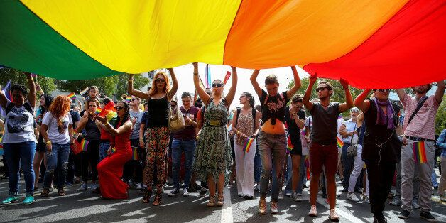 Participants hold a rainbow flag during an annual LGBT (Lesbian, Gay, Bisexual and Transgender) pride...