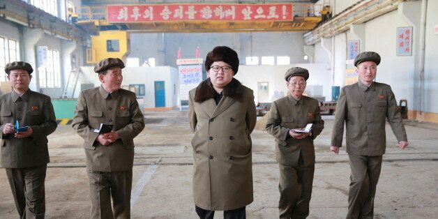 North Korean leader Kim Jong Un (C) visits the February 11 plant at the Ryongsong Machine Complex in...