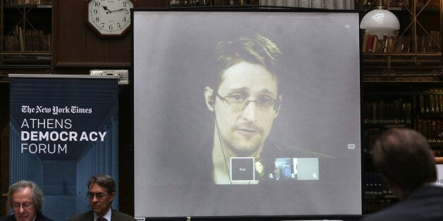 National Security Agency leaker Edward Snowden speaks via video link during the Athens Democracy Forum,...