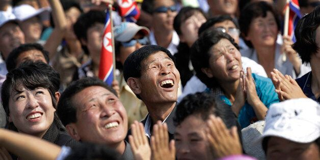 North Koreans watch an aerial display on Saturday, Sept. 24, 2016, in Wonsan, North Korea. North Korea...