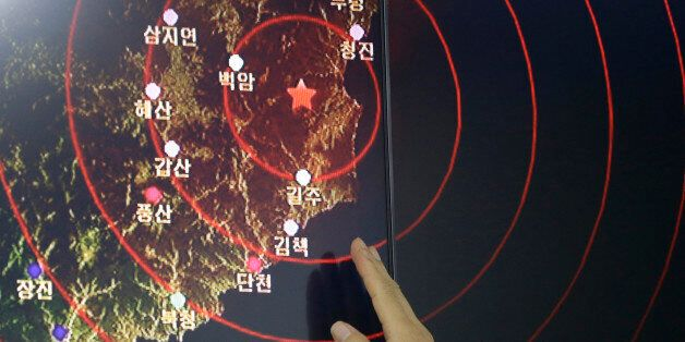 An official of the Earthquake and Volcano of the Korea Monitoring Division points at the epicenter of...