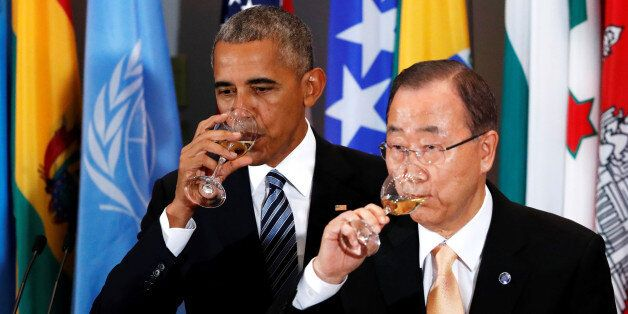 U.S. President Barack Obama and UN Secretary General Ban Ki-moon share a toast at a luncheon during the...