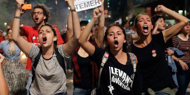 EDS NOTE GRAPHIC CONTENT - OBSCENE GESTURE - Demonstrators shout slogans against acting Brazil's President...