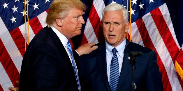 Republican presidential candidate Donald Trump, left, greets vice presidential candidate Gov. Mike Pence...