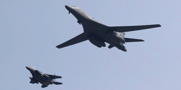 U.S. B-1B bomber, right, flies over Osan Air Base with South Korean Air Forces jet in Pyeongtaek, South...