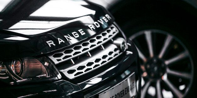 Range Rover Evoque cars are on display at a car dealer in Berlin, August 23, 2014. The German premiums...