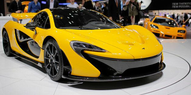 People look at the new McLaren P1 during the 83rd Geneva International Motor Show, Switzerland, Monday,...