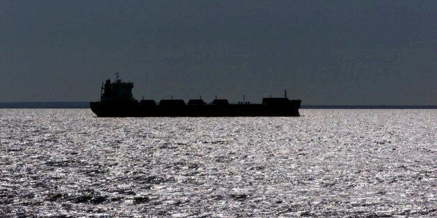 FILE -- In this July of 1999 file photo, a freighter is silhouetted in Lake Superior near Whitefish Point,...