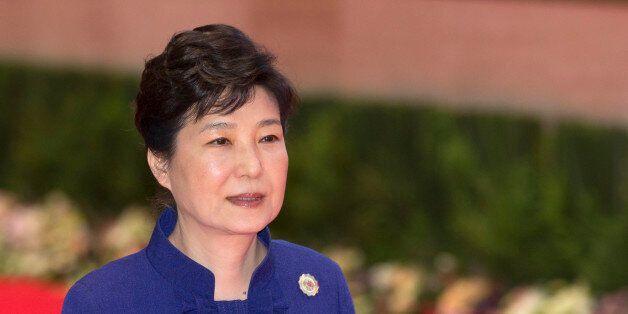 South Korea's President Park Geun-hye walks to participate in the 18th ASEAN-Republic of Korea summit,...