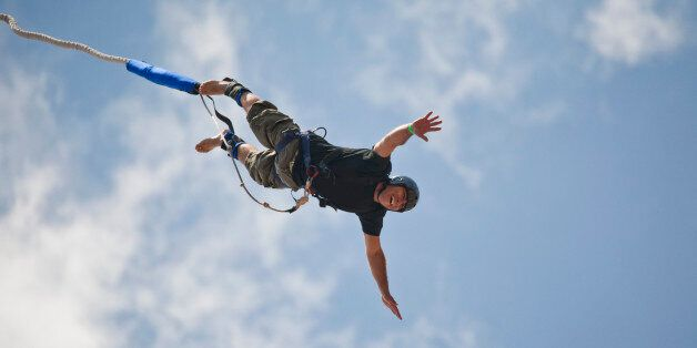 Bungee jumping man against