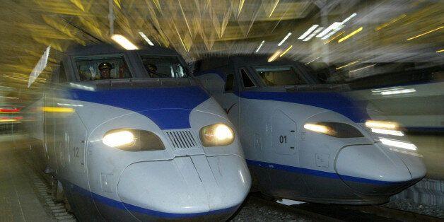 A South Korean KTX train (L) prepares to depart for Pusan city at the Seoul railway station April 1,...