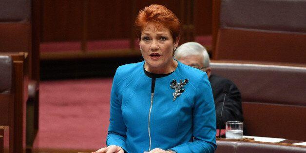 Australia's One Nation party leader Senator Pauline Hanson makes her maiden speech in the Senate at Parliament...