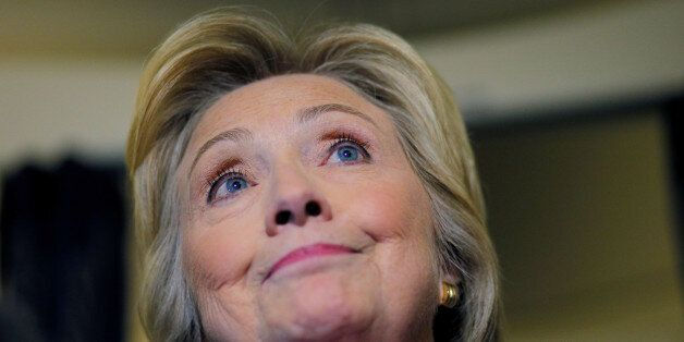 U.S. Democratic presidential nominee Hillary Clinton answers a question from a reporter on her campaign...