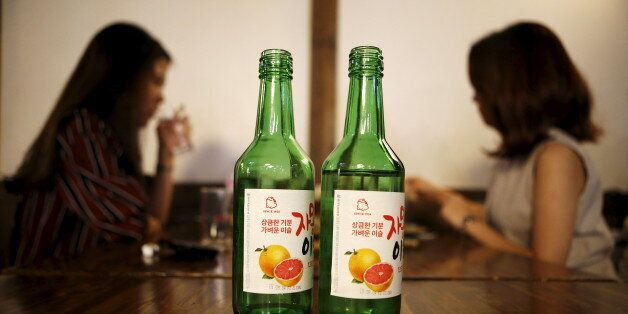 Bottles of fruit flavoured and low-alcohol soju are seen in this picture illustration at a pub in Seoul,...