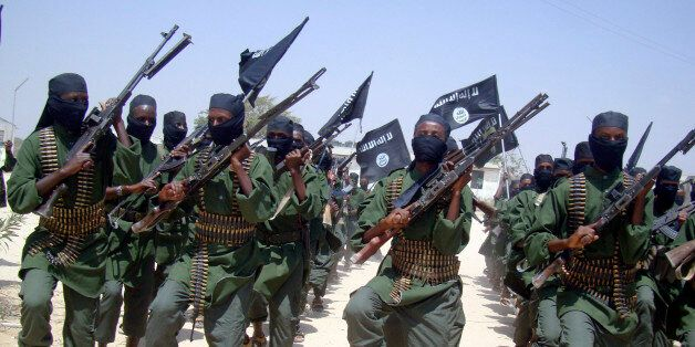 FILE - In this Thursday, Feb. 17, 2011 file photo, al-Shabab fighters march with their weapons during...