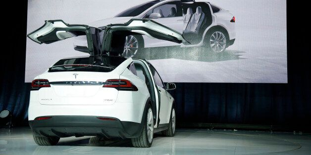 The Model X car is unveiled at the company's headquarters Tuesday, Sept. 29, 2015, in Fremont, Calif....