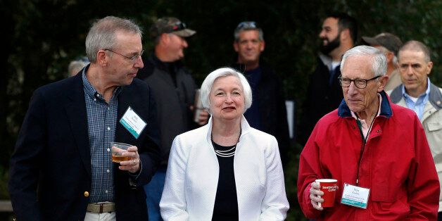 Federal Reserve Chair Janet Yellen, center, strolls with Stanley Fischer, right, vice chairman of the...