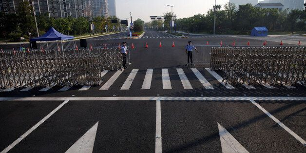Policemen secure the road near the venue of the G20 Summit in Hangzhou, Zhejiang province, China September...