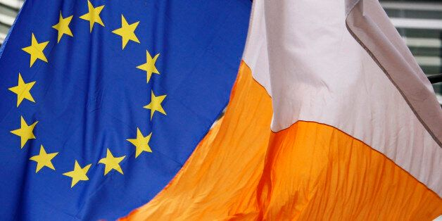 An Irish flag flies next to an European Union flag in front of the EU Commission headquarters in Brussels...