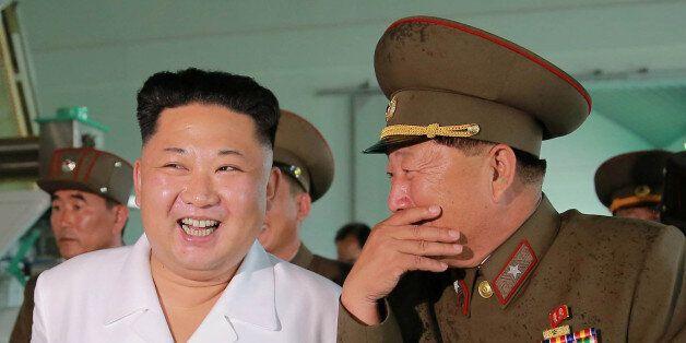 North Korean leader Kim Jong Un visits a Fish Food Factory run by KPA Unit 810, in this undated photo...