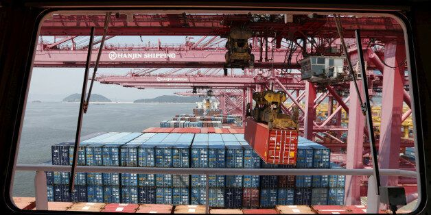 A crane carries a container from a ship of Hanjin Shipping at Hanjin container terminal at the Busan...