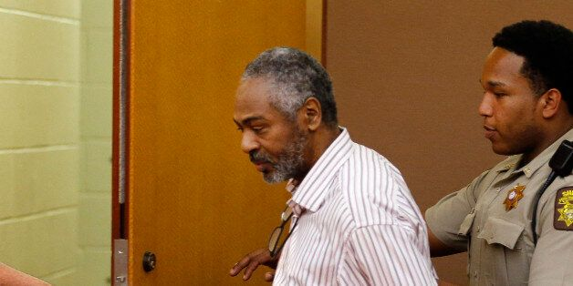 Martin Blackwell is led out of a courtroom after being found guilty during his trial in Atlanta, Wednesday,...