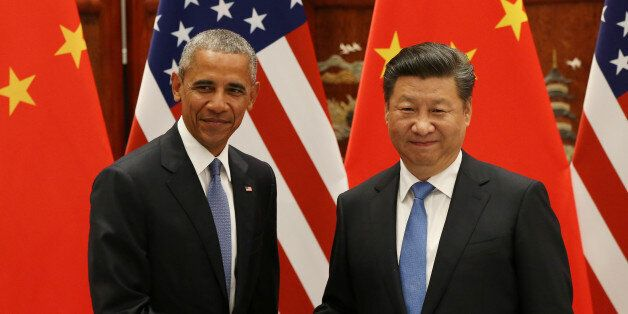 U.S. President Barack Obama and Chinese President Xi Jinping shake hands during their meeting ahead of...