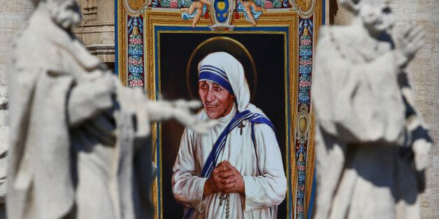 A tapestry depicting Mother Teresa of Calcutta is seen in the facade of Saint Peter's Basilica during...