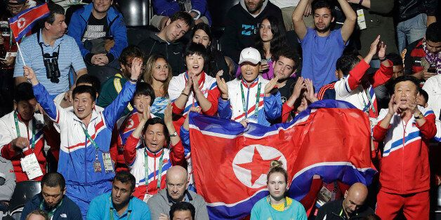 Spectators cheer for Kim Song I, of North Korea, as she plays against Ai Fukuhara, of Japan, during the...