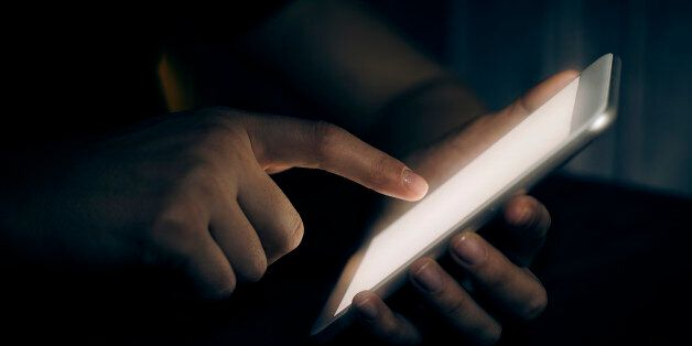 Hand touching digital tablet in