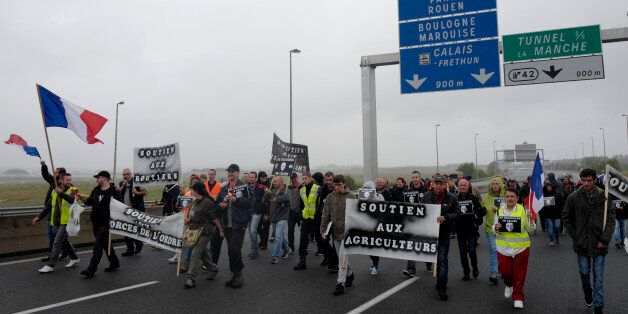People block the highway leading to Calais and the Channel tunnel in Calais, northern France, Monday,...