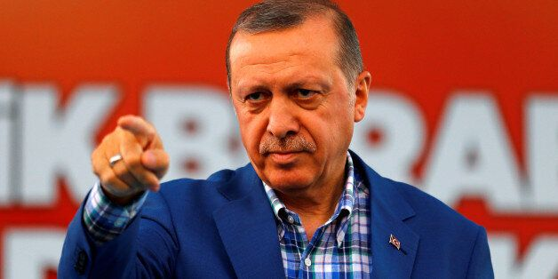 Turkey's President Tayyip Erdogan points at the United Solidarity and Brotherhood rally in Gaziantep,...