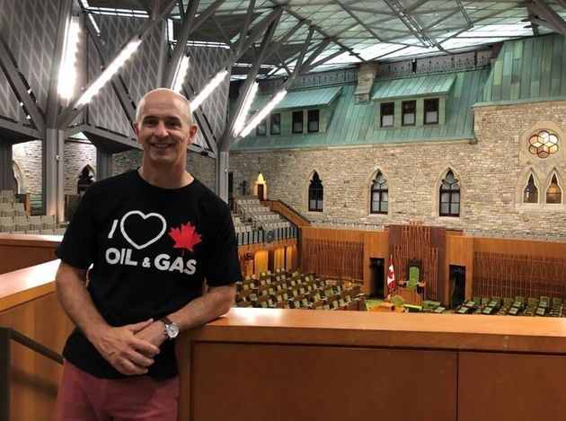 William Lacey says in an open letter that Senate security staff made him turn his pro-oil shirt inside
