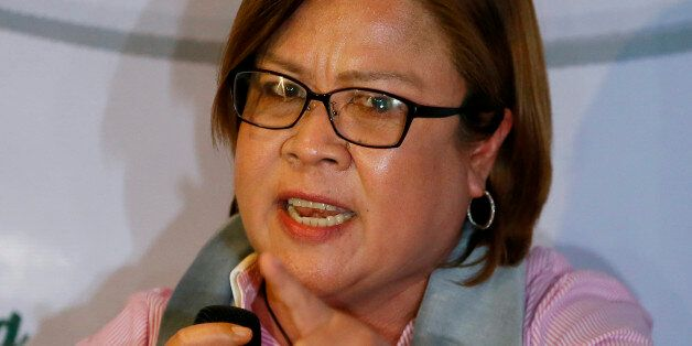 Former Justice Secretary and now Senator Leila De Lima gestures during a news conference she called to...