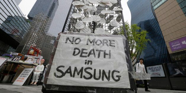 In this April 22, 2016 photo, messages for victims who were former employees at Samsung semiconductor...