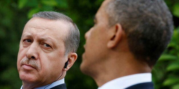 FILE PHOTO - Turkish Prime Minister Recep Tayyip Erdogan (L) listens as U.S. President Barack Obama (R)...