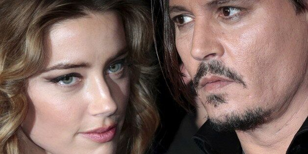Cast member Johnny Depp and his actress wife Amber Heard arrive for the British premiere of the