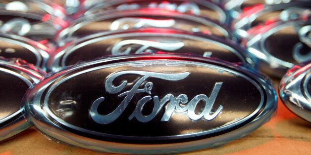 Ford logos are seen at the assembly line of the Ford car factory of Saarlouis, December 6, 2010. REUTERS/Vincent...