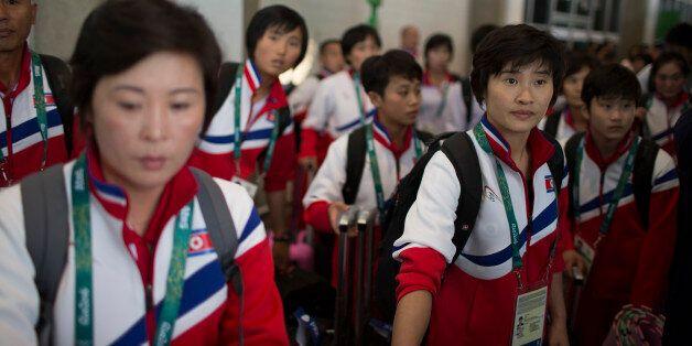 Members of the North Korean olympic team arrive to the Rio de Janeiro International Airport in Rio de...